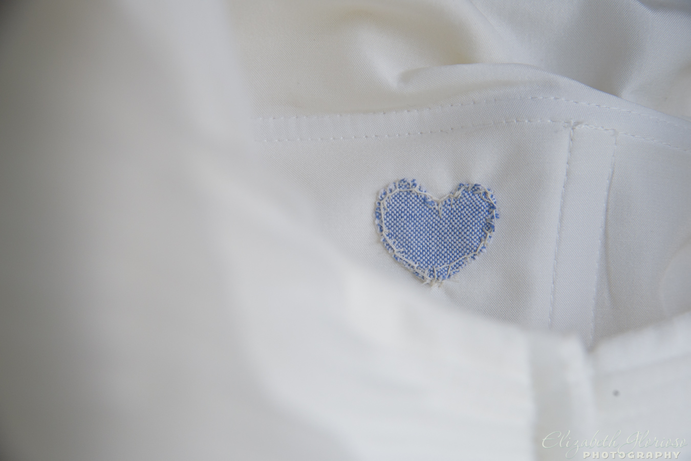 "Amanda's ""something blue"" sewn inside of her wedding dress and close to her heart."