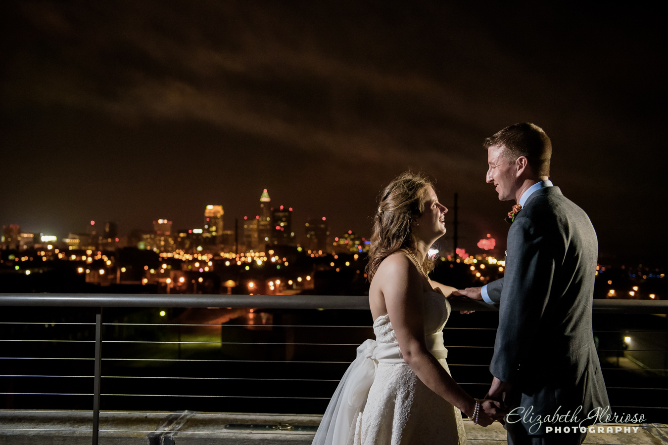 Bride and Groom night portrait with Cleveland Skyline