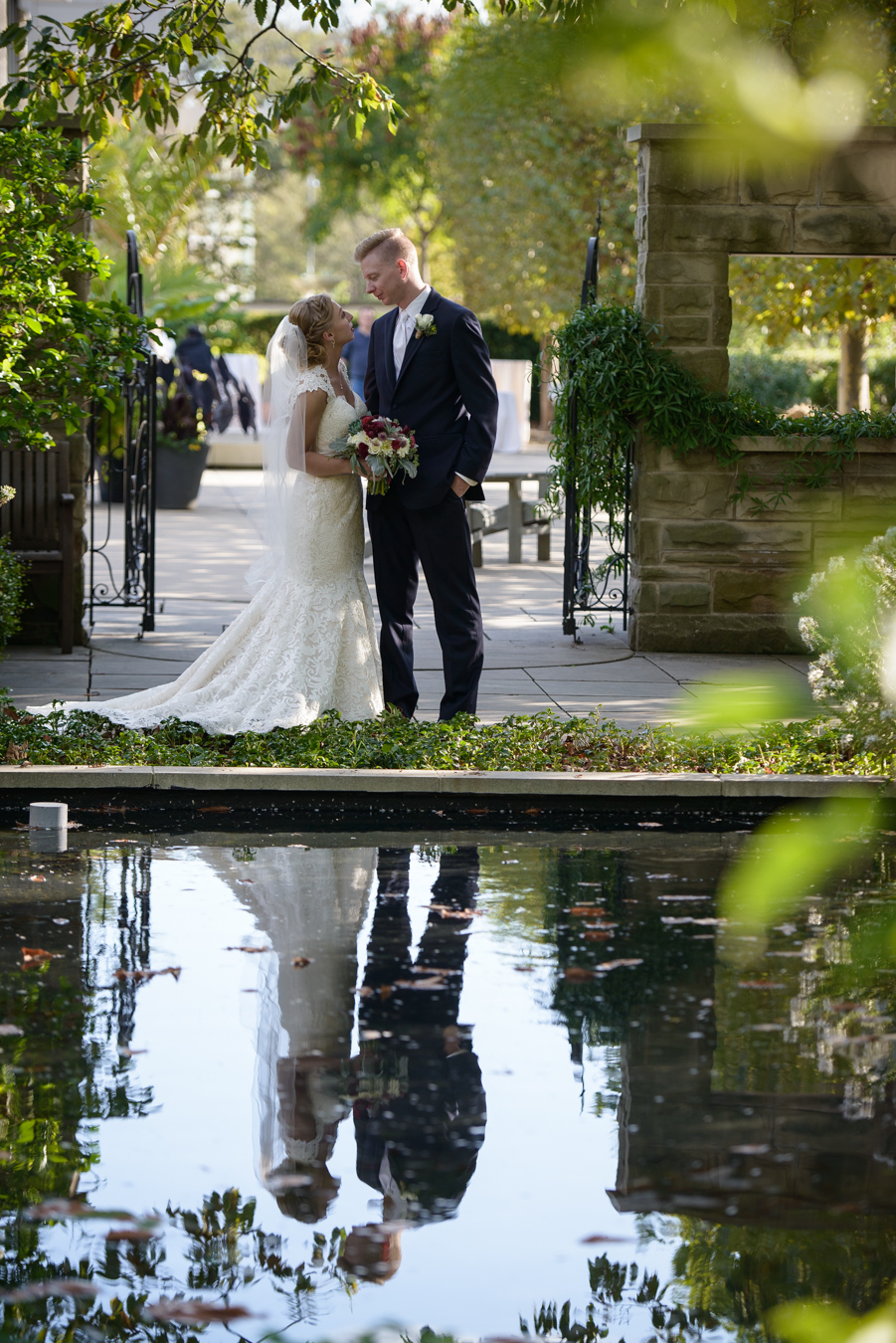 Bride and Groom at the reflecting pond at the Cleveland Botanical Garden
