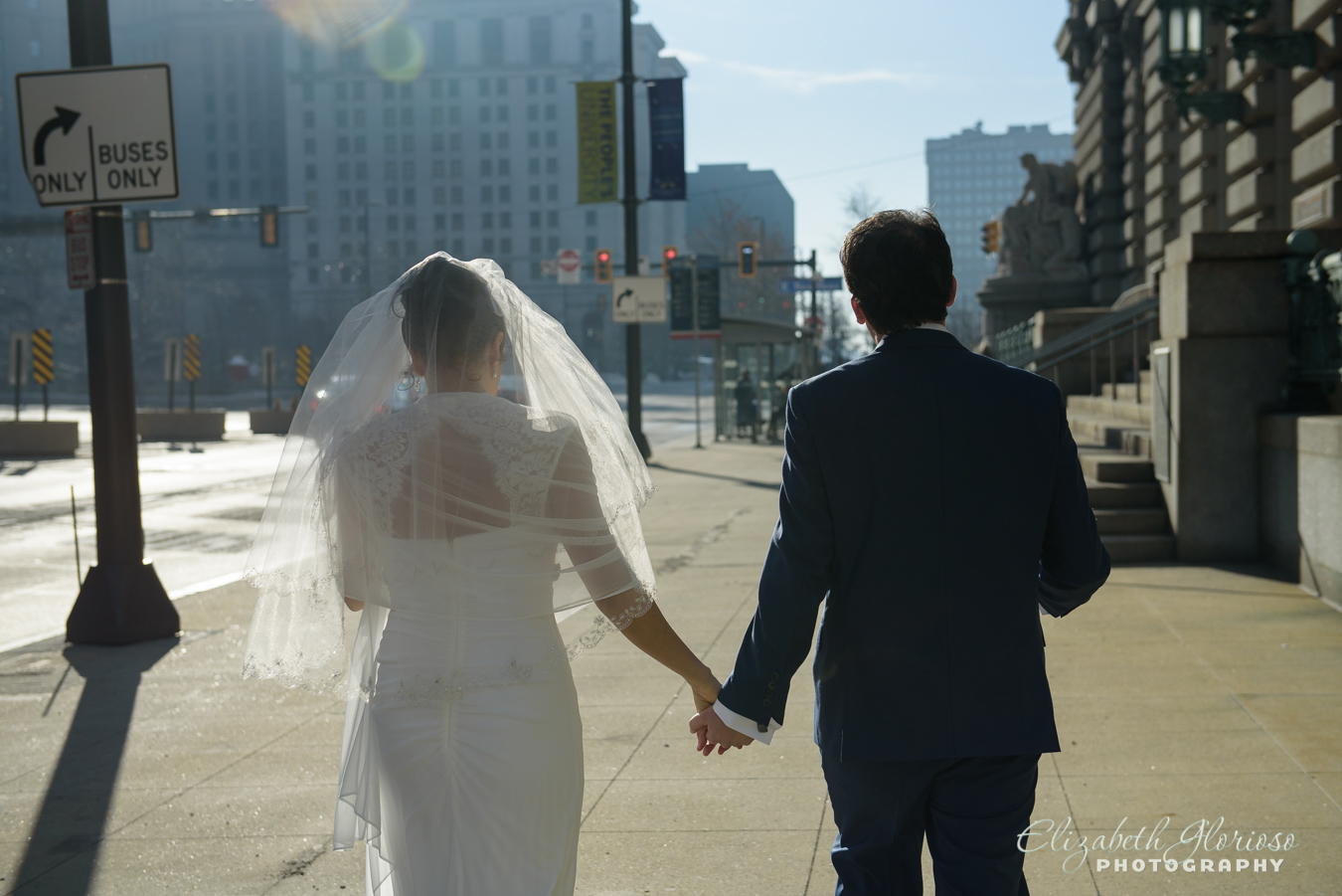 Bride and groom walking downtown Cleveland Ohio