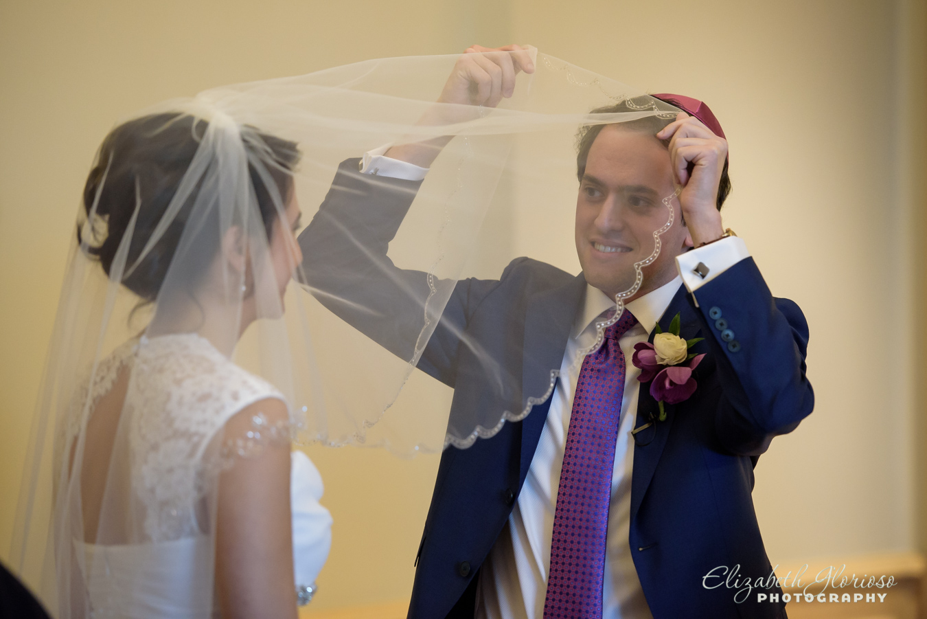 Groom looking under the bride's veil Cleveland Ohio
