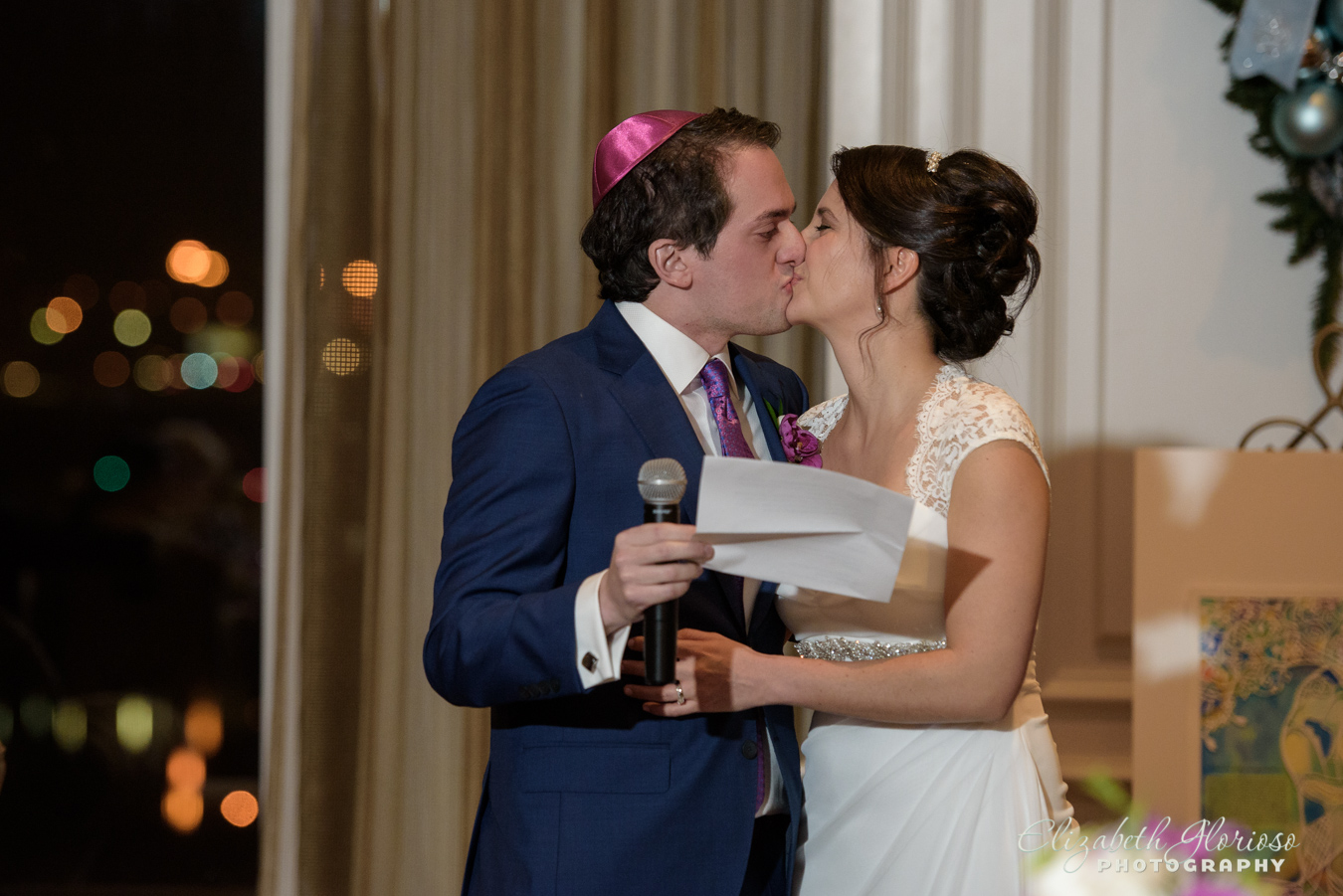 bride and groom kiss wedding reception Ritz Carlton Cleveland Ohio