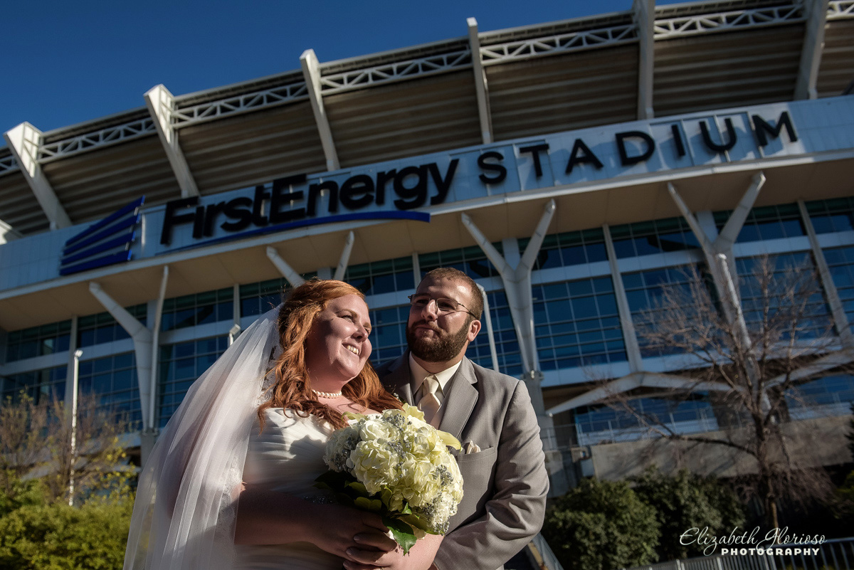 Photo of bride and groom outside of Browns Stadium in Cleveland, OH