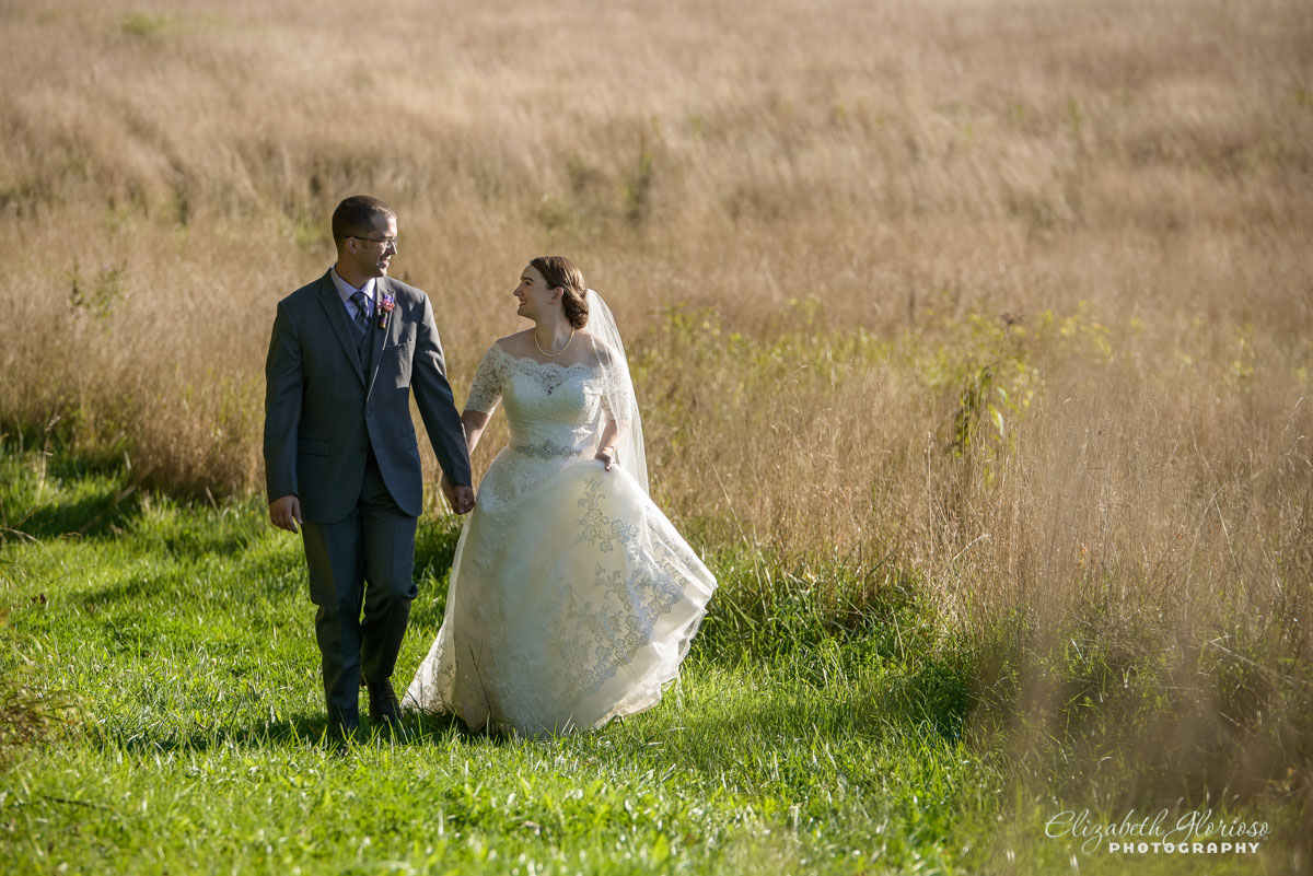 Photo of bride and groom walking hand-in-hand taken in Burton, Ohio